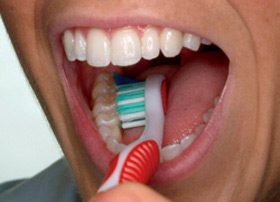 Brush the inner tooth surfaces, still with the toothbrush at a 45-degree angle.