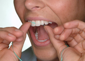 Hold the floss tightly between your thumbs and forefingers. Guide the floss between your teeth, using a gentle rubbing motion. To avoid hurting your gums, never snap the floss into gum tissue.
